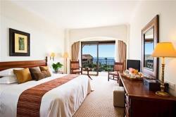 Elysium Deluxe Bedroom with Sea View
